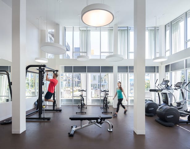 A pool deck adjacent gym has the latest fitness equipment.