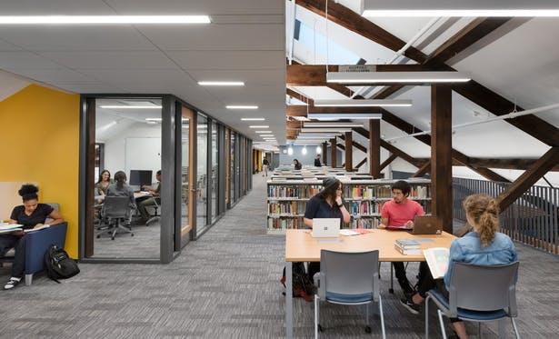 The renovated attic is day-lit from the floor below and new skylights, accommodating group study and conference rooms for the Learning Commons. Photo credit: Chuck Choi