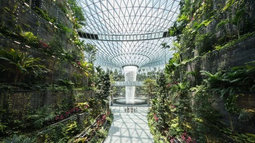 Changi Airport's Rain Vortex is a 130-foot indoor waterfall. Image courtesy of Changi Airport Group