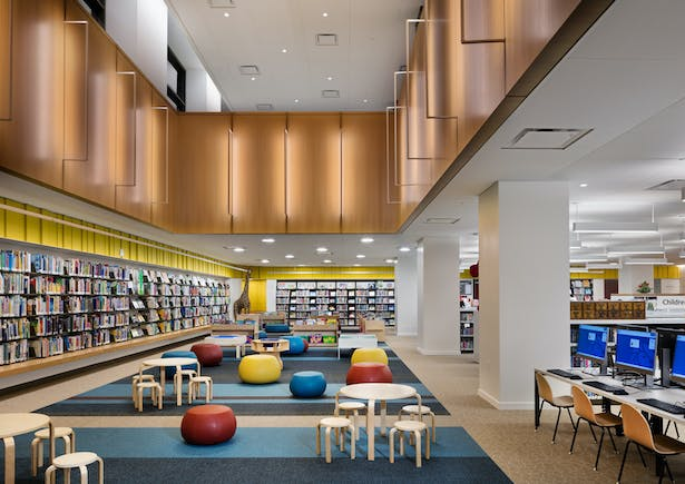 On the other side, a rectangular opening in the floorplate reveals the lower ground floor, which houses a Children's Library and Teen Center. Image copyright by John Bartelstone
