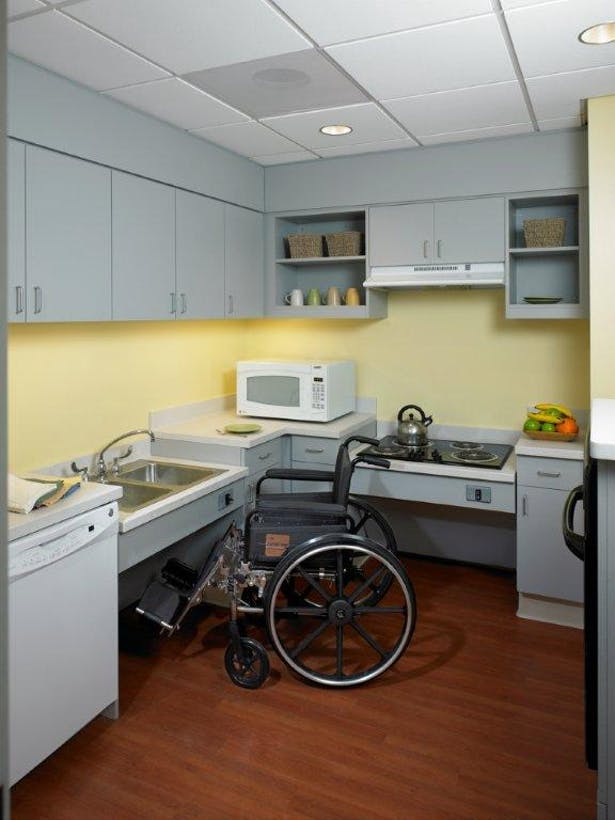 Assisted Daily Living kitchen with vertically adjustable sink and stove top. Not seen: Full size refrigerator, oven, washer and dryer