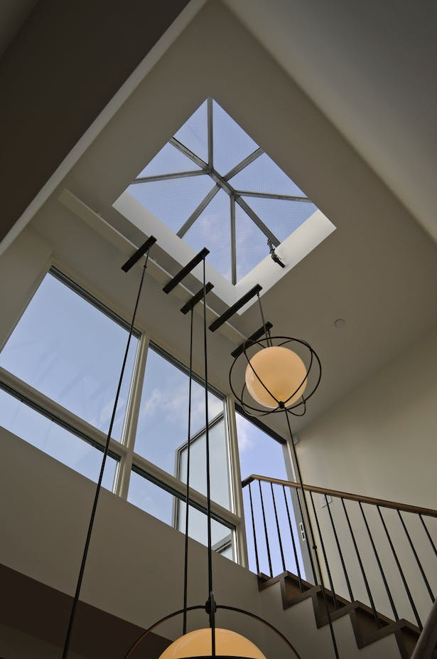Skylight and wall of glass to bring natural light to lower floors