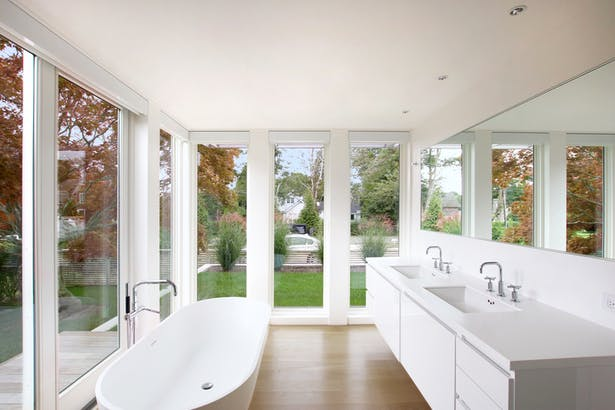 A Soaking Tub in the Master Bath Overlooks an Existing Japanese Maple Tree
