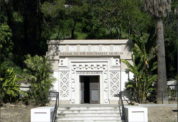 A Mayan-Revival gate marks the main pedestrian entrance to the museum. Image courtesy of The Autry.