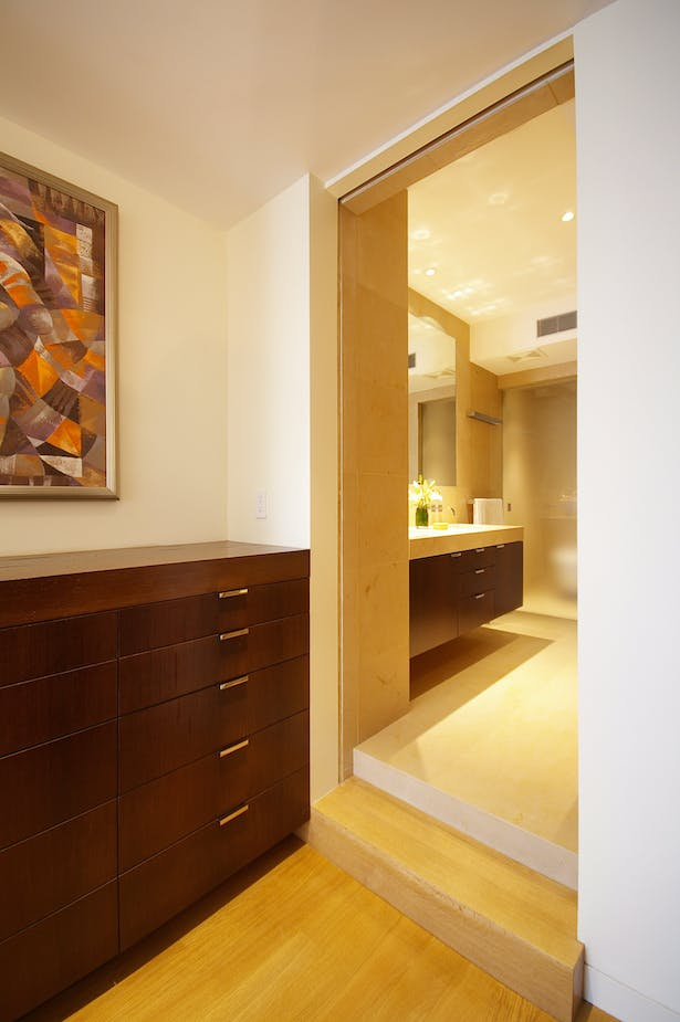 The details and materials of the living floor are repeated throughout the master suite