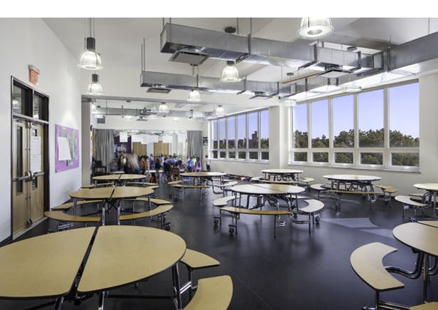The Multi-Purpose room serves as Cafeteria, Dance, and movement space all with a dynamic view over the treetops.