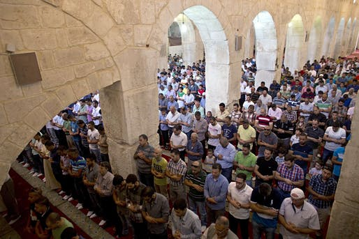 A 2014 photo of Palestinian Muslims in the Marwani Prayer Room in the Al-Aqsa Mosque. Credit: Ahmad Gharabli/AFP/Getty Images, via Newsweek.