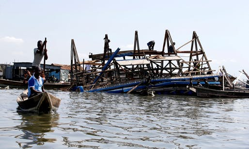 Residents work to dismantle the Makoko Floating School after it collapsed on Tuesday. Photograph: Akintunde Akinleye/Reuters