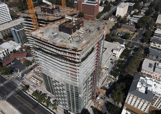Aerial view of the towers' topping out. All images courtesy of Bayview Development Group.