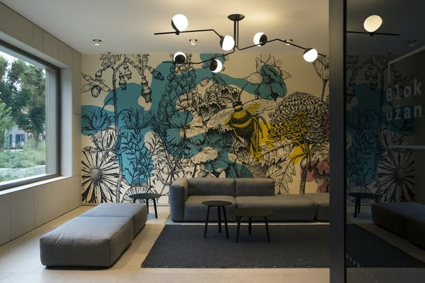 """One of the entrance spaces features a mural """"Meadow from a dream"""" by Miron Milic"""