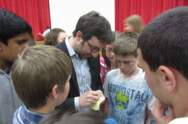 Danny Forster, who hosts Build It Bigger on the SCIENCE channel, signs autographs inside the gymnasium at Chippewa Middle School after his presentation. (Jennifer Delgado/Tribune)
