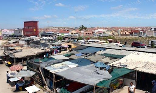 An 'active box' – part community centre, part safe haven – rises above the market of Cape Town's Khayelitsha township. (The Guardian; Photograph: Joy McKinney)