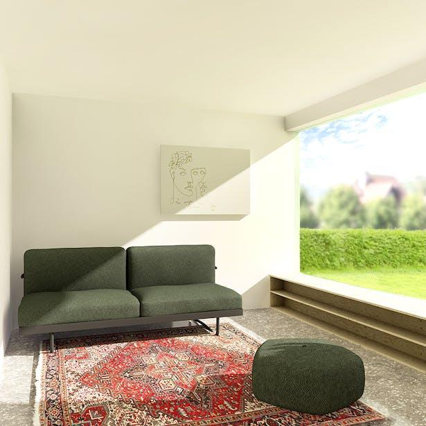 In de zitkamer is massieve geborgenheid voelbaar. Eenduidige openingen naar de tuin en de tuinkamer geven deze atmosfeer heldere kaders.