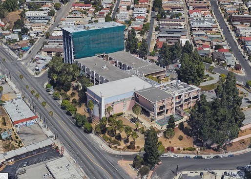 Aerial view of the site on Sunset Boulevard. The mid-rise structure in the back has recently been converted into an apartment building. Image via Google Maps.