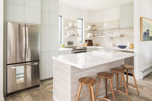 Completely renovated modern kitchen filled with custom cabinetry that's easy to access for the whole family.