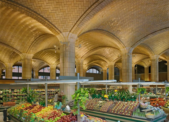 Architect Henry Hornbostel called on the Guastavino Company to design a vaulted arcade below the approach to the Queensboro Bridge, to serve as a public market. Visually, the canopy of tile vaulting transformed a regular grid of columns into a soaring celebration of public space. Photo © Michael Freeman. Courtesy of the Museum of the City of New York