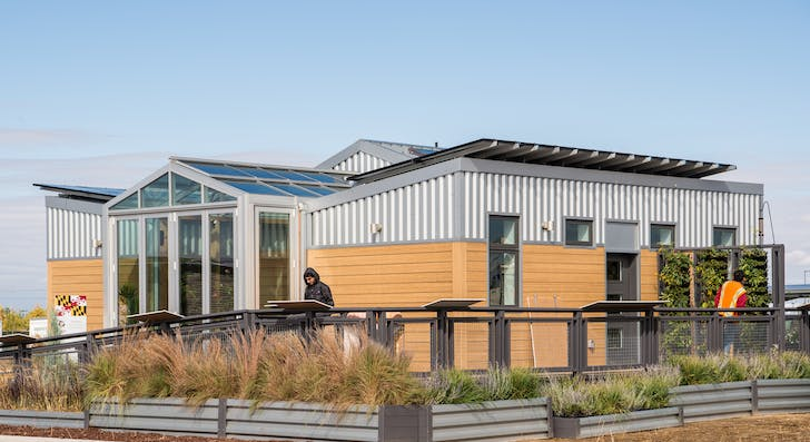 8517375bd Exterior of the U.S. Department of Energy Solar Decathlon 2017 University  of Maryland team reACT competition house at the 61st   Peña Station