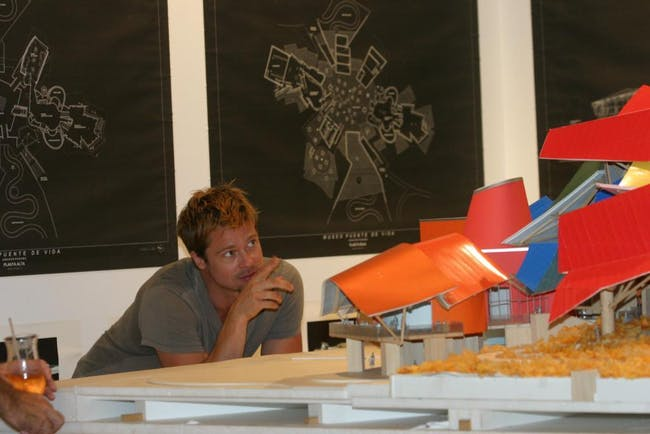 Brad Pitt looking at model for Frank Gehry designed Biomuseo in Panama