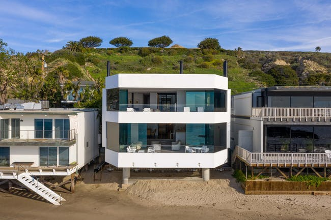 Aerial view of the home's oceanfront facade. Images courtesy of Matthew Momberger.