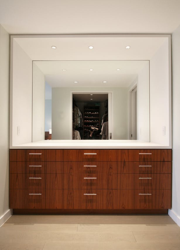 Built-In Master Dresser with Corian Sleeve Opposite Master Closet