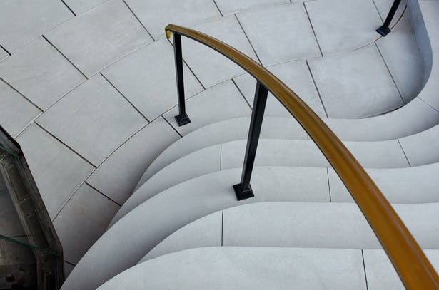 Curved stairs create a small amphitheater area