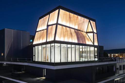 DFAB HOUSE and the NEST building illuminated against the night sky. (Photograph: Roman Keller)