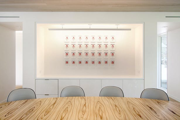 A Corian Sleeve in the Dining Area Makes the Artwork Focal