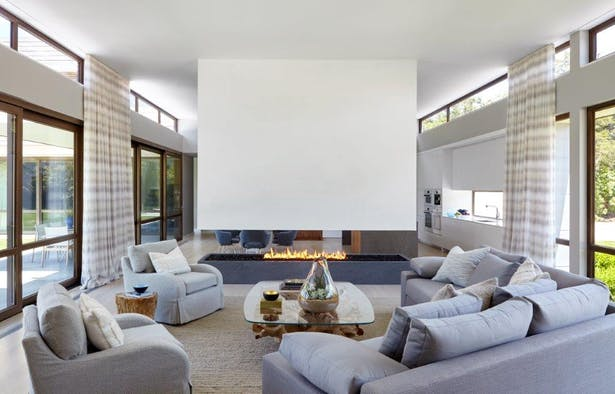 Living Room with floating plaster fireplace. Joshua McHugh Photography