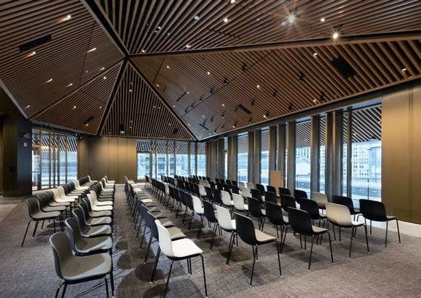 The new floor has pitched wood slat ceilings and contains a flexible 268-occupant conference and event center. Image copyright by John Bartelstone