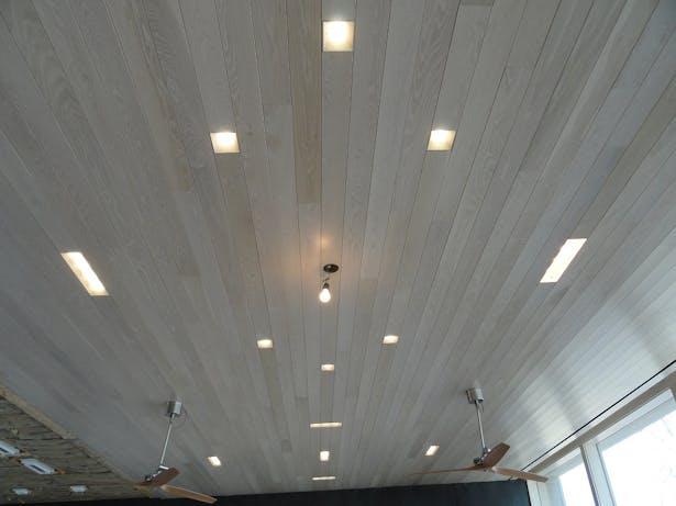 Main house custom light fixtures with wood trim