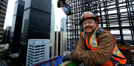 Working 300 feet above downtown Los Angeles, ironworkers position reinforcing steel onto the walls of the New Wilshire Grand. (via latimes.com; Photo: Mel Melcon)