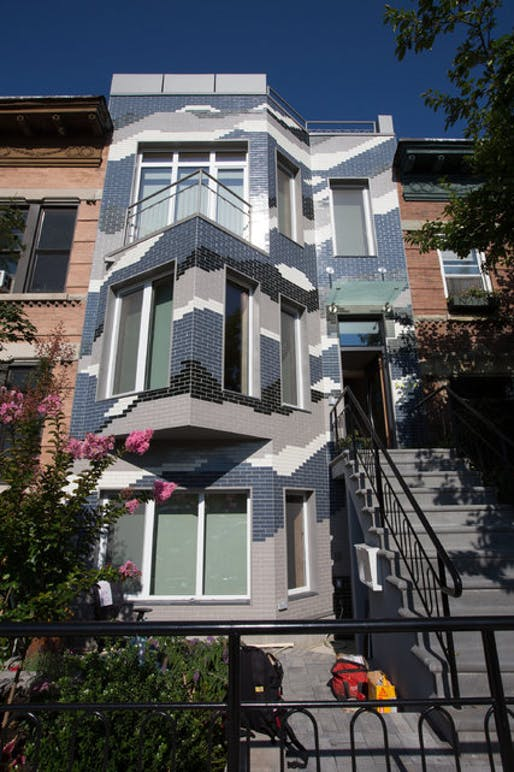 The exterior of Mr. Paino's home, which he calls the Climate Change Rowhouse. Credit Ruth Fremson/The New York Times
