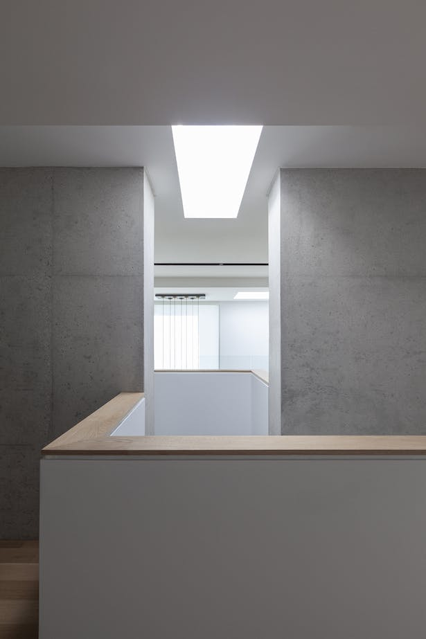 staircase / concrete wall / light well