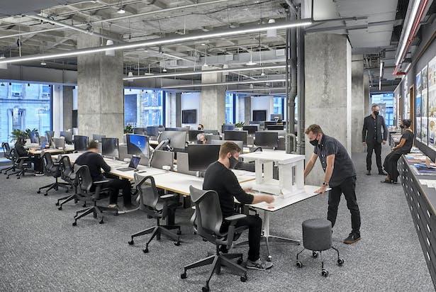The studio's 70 foot pin-up space celebrates the design process. Photo Credit: Garrett Rowland