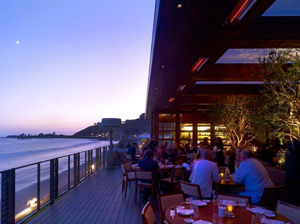 Diners enjoy sunset on the dining deck