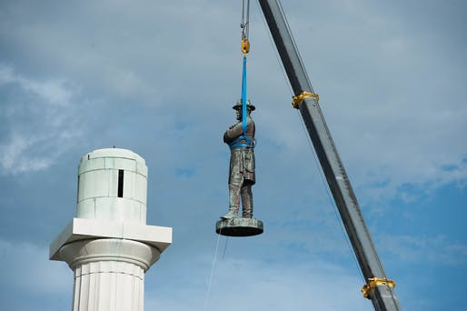 "View of a statue commemorating confederate general Robert E. Lee being removed in New Orleans in 2017. Photo courtesy of Wikimedia user<a href=""https://commons.wikimedia.org/wiki/File:Lee_Removal.jpg"">Abdazizar</a>"