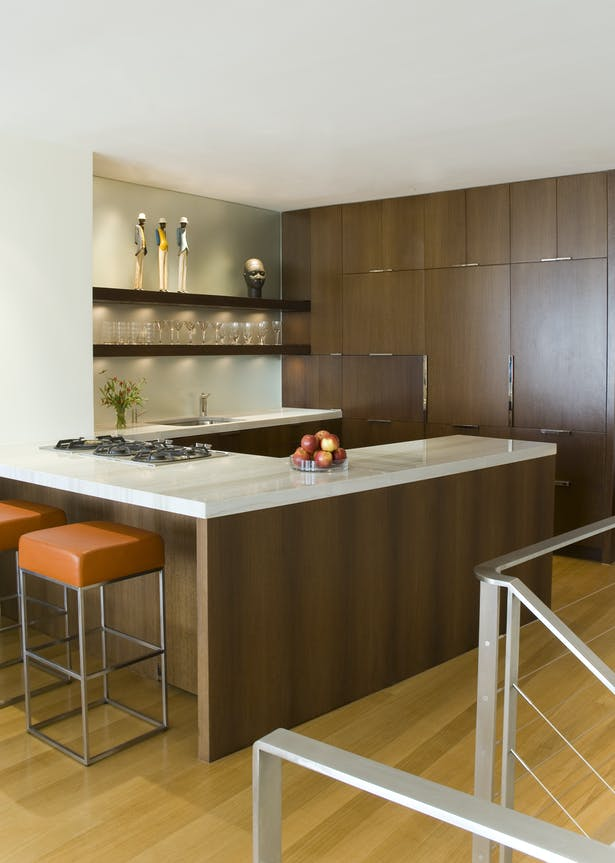 The open kitchen was designed to reinforce the modern aesthetic vision for the apartment without sacrificing function.
