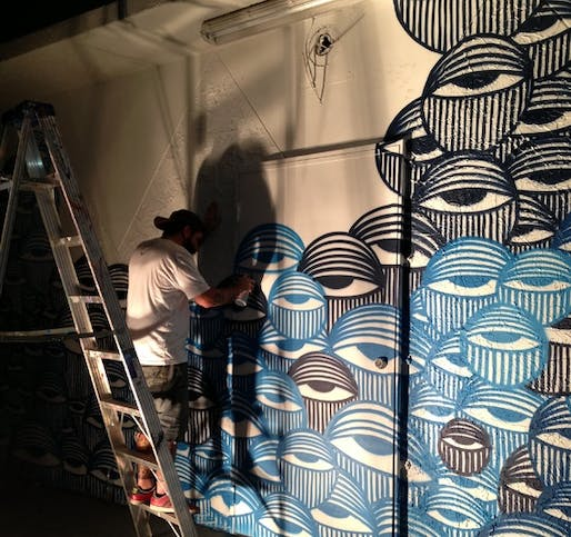 In Miami's Wynwood Arts District, David Anasagasti works on his 'Ocean Grown' mural, a mural at the center of a copyright infringement dispute with American Eagle Outfitters. (via The Atlantic)