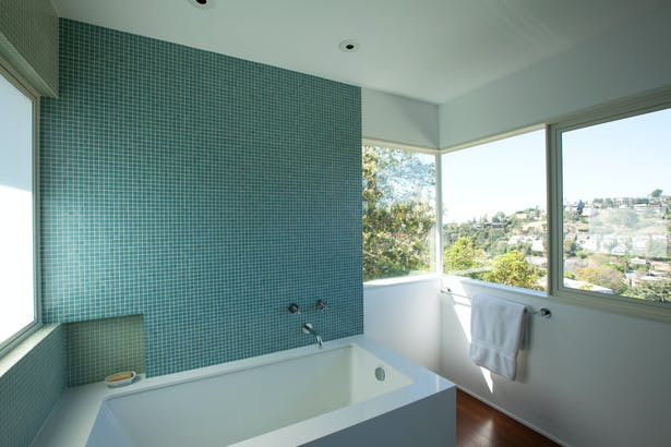 The bathroom windows include views of the Hollywood Hills and Silverlake; while soaking in the bathtub, the owners' see only the Hollywood Sign, the Griffith Park Observatory and the mountains of Griffith park.