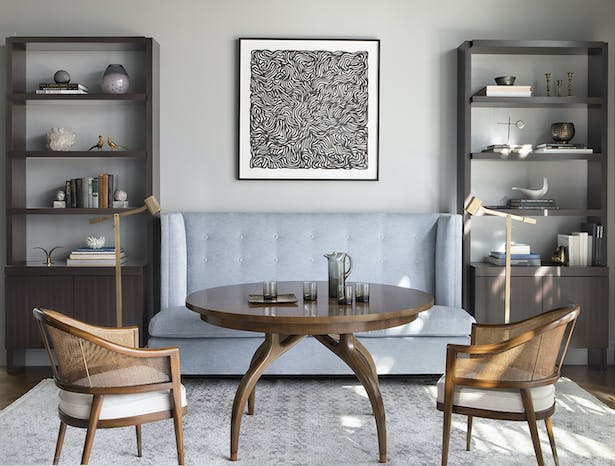 The custom-designed Niche Interiors banquette, Alfonso Marina chairs and Dessin Fournir table often host family game nights.