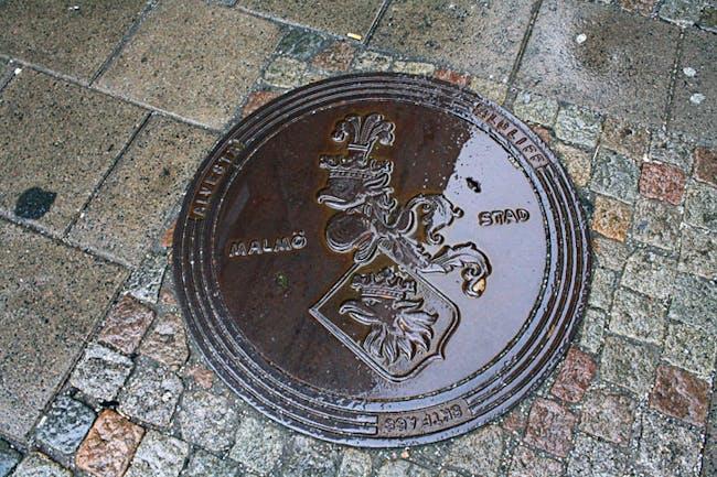 Malmö's crest on manhole cover