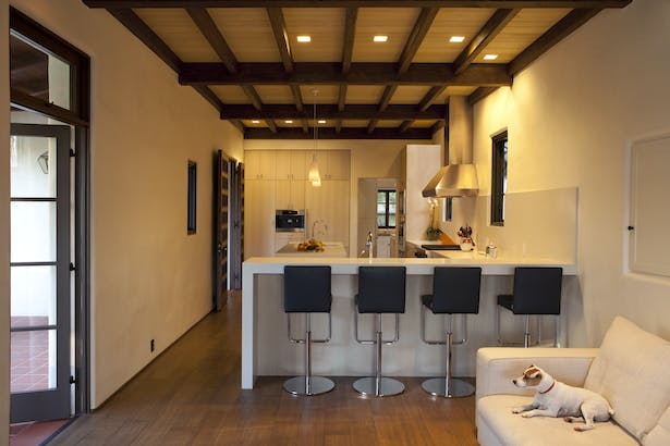 While the kitchen is modern in design and conveniences, it complements the overall aesthetic of the original adobe house.