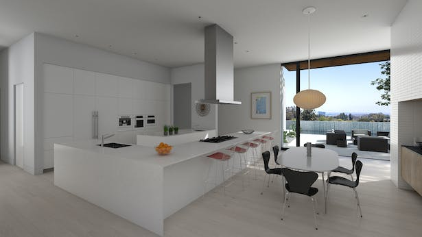 The kitchen and informal dining area. The full height doors slide all the way open so the dining area connects directly to the pool terrace.
