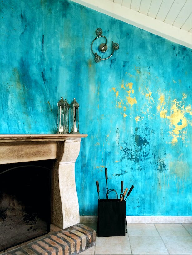 renovated fire place - and distressed walls