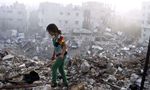 A Palestinian girl walks in Gaza's Shejaiya neighbourhood, one of the hardest hit by recent fighting. (The Guardian; Photograph: Roberto Schmidt/AFP/Getty Images)