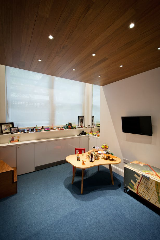 Emphasizing the Concept of a Millwork Insertion, Wood Ceilings are Carried Through