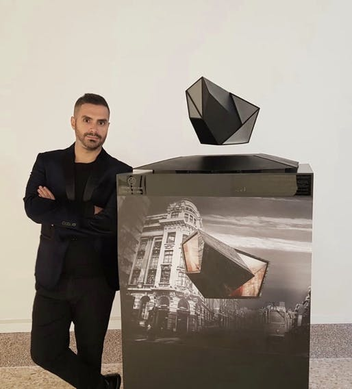 AUD chair of architecture Georges Kachaamy standing next to his floating model prototype 'Air Oases.' Image courtesy of Georges Kachaamy, via @AUDubai/Twitter