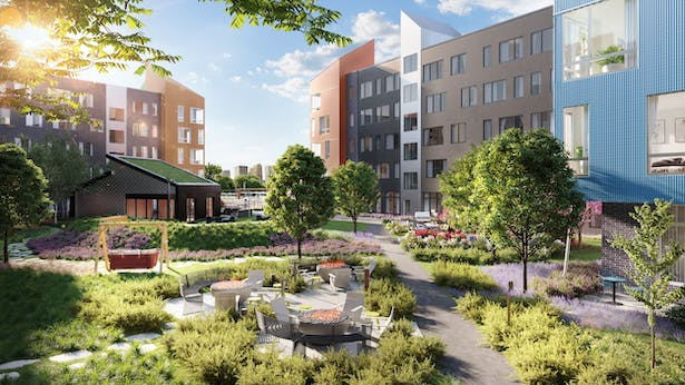 Outdoor courtyard and building exterior at The Eddy in Harrison, NJ. Image courtesy of QuallsBenson.