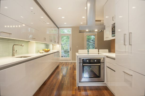 The minimalist kitchen was designed to be the center of life in this family home.