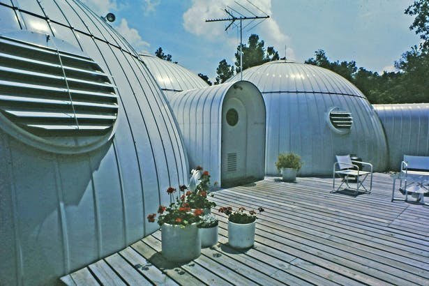 four twenty six foot domes merged together like soap bubbles form the exterior shell of the 1700 square foot house.